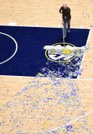 Mar 17, 2019; Nashville, TN, USA; A member of the Bridgestone Arena crew sweeps confetti off the court after a win by the Auburn Tigers over the Tennessee Volunteers in the SEC conference tournament championship game at Bridgestone Arena. Mandatory Credit: Christopher Hanewinckel-USA TODAY Sports - 12368716